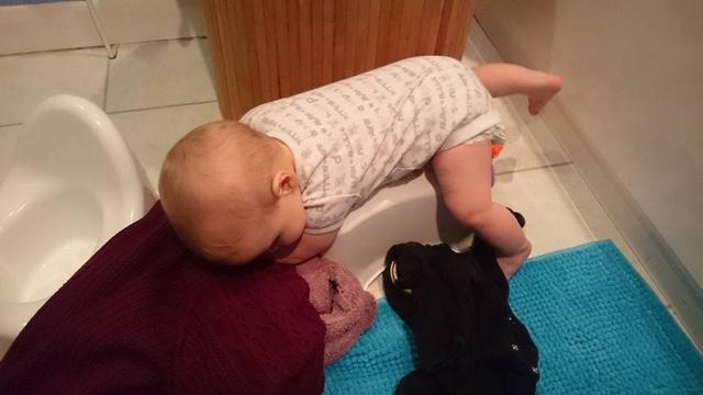 Baby climbing over a stool