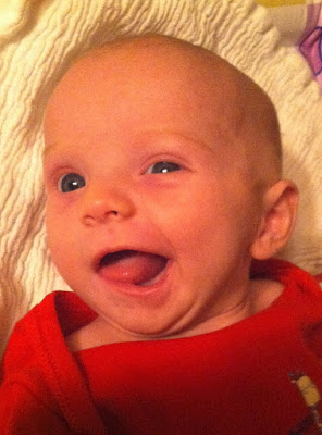 Totally smiling aged three weeks and not wind. How dare you imply that