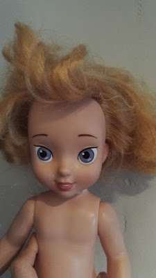 fixing matted doll's hair
