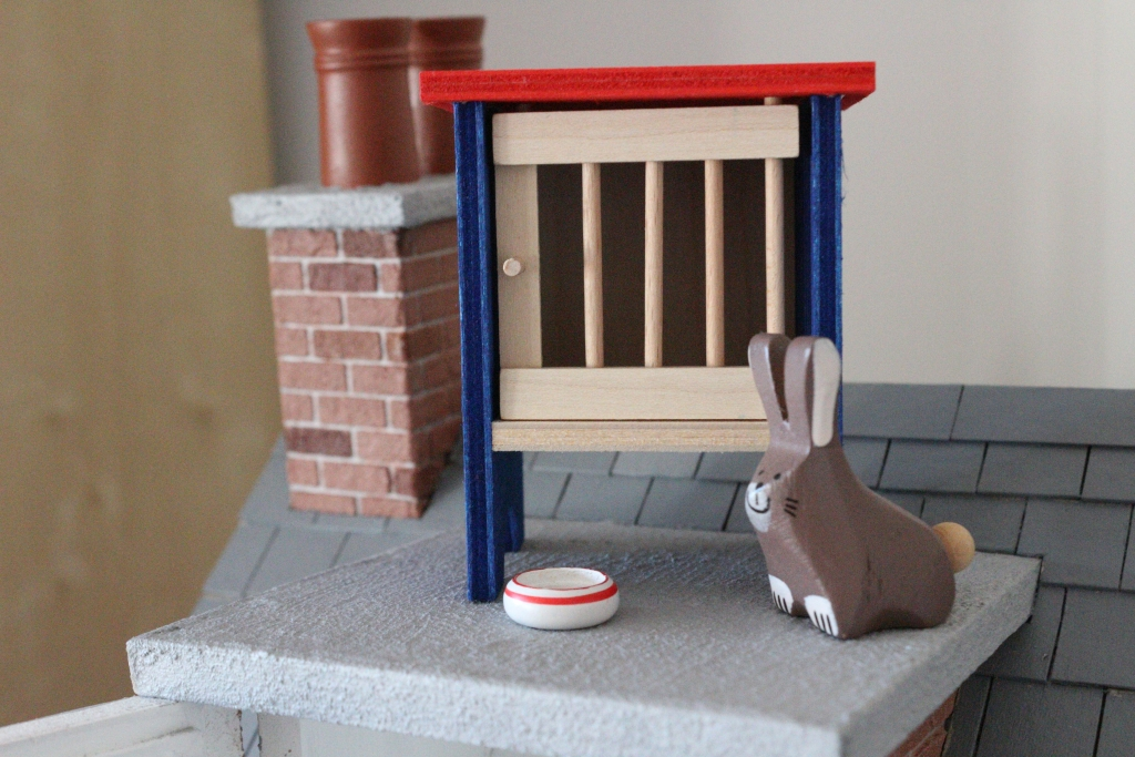 rabbit on roof dolls house