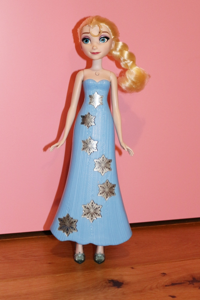 Naked Elsa play-a-melody doll