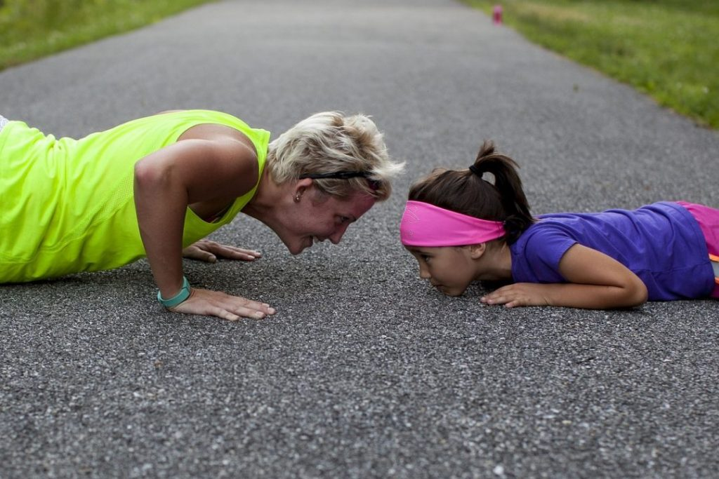 mom exercising with kids