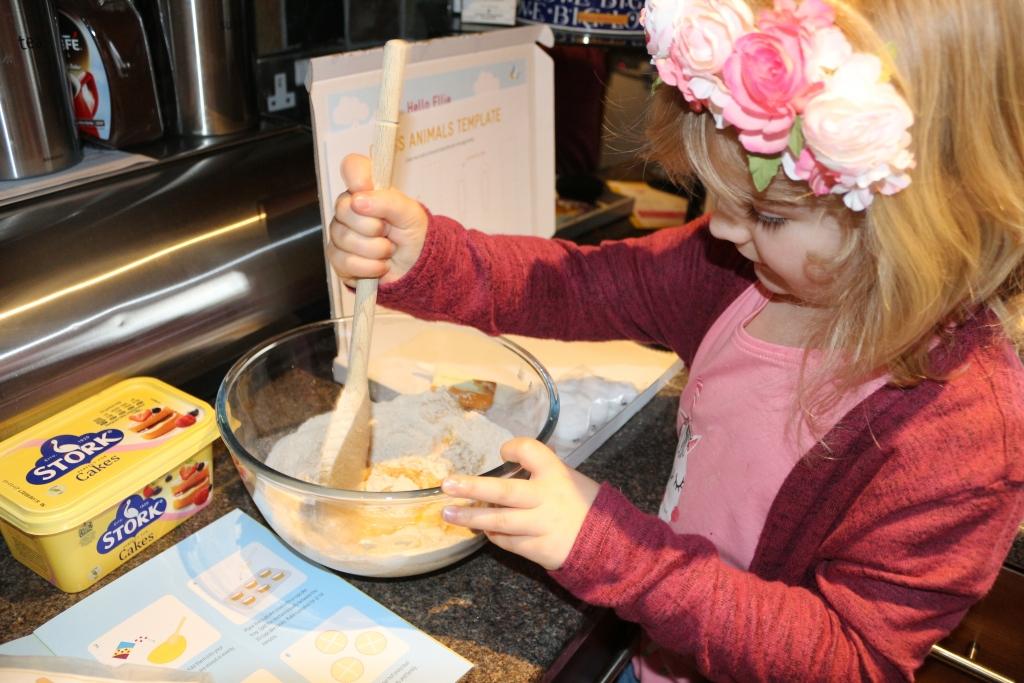 Mini Baker's Club mixing the cake