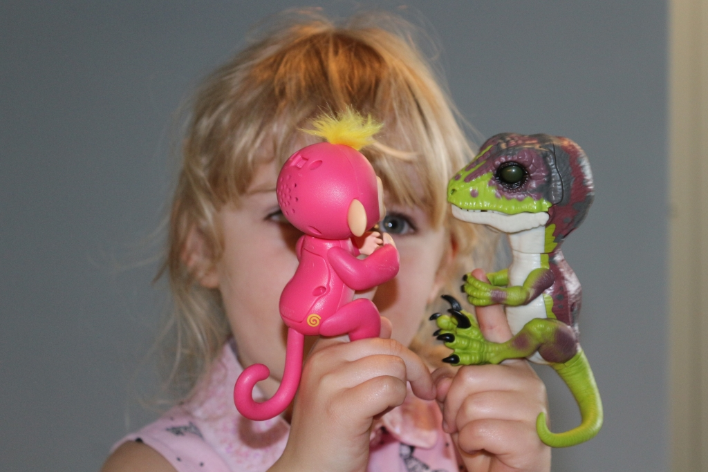 Untamed Raptor Fingerlings Dinosaur (Stealth) and pink Fingerling Monkey