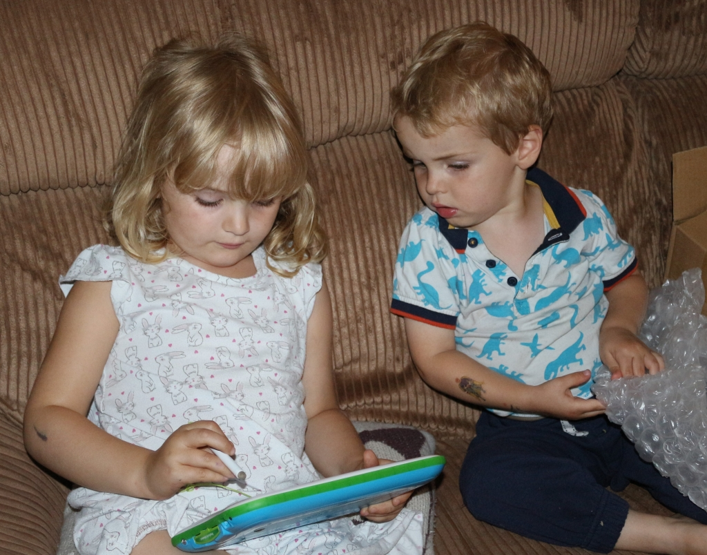 Sibling harmony - sharing the LeapPad Ultimate. Kind of