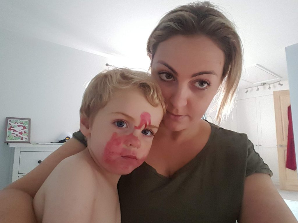 Got into the make up back - lipstick on his face