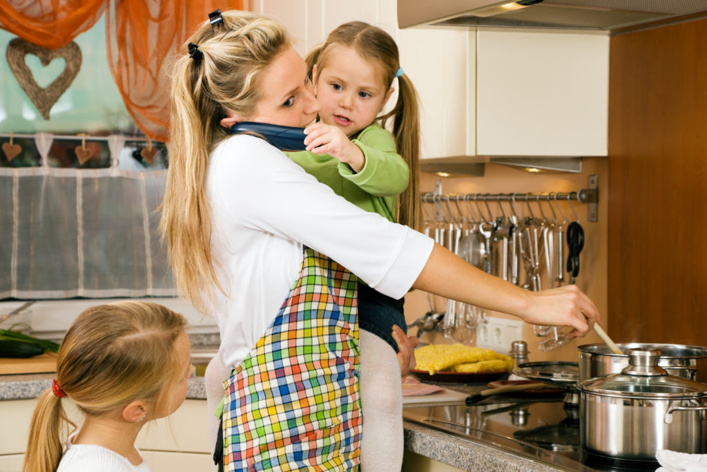 Mother with children cooking