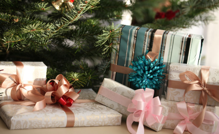 beautiful christmas presents with bows by tree