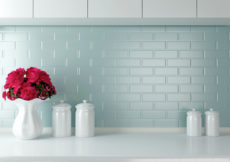 Ceramic tableware on the worktop. White kitchen design.