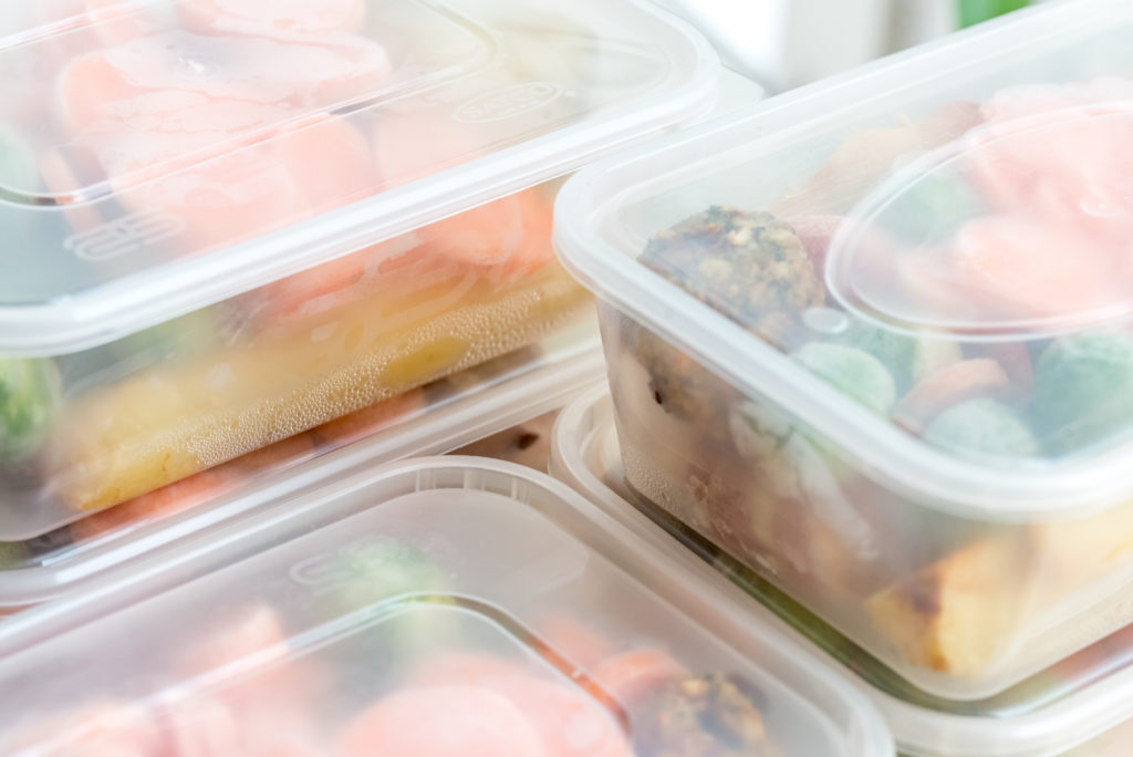 Meal prep. Close up of home cooked roast chicken dinners in containers ready to be frozen for later use.