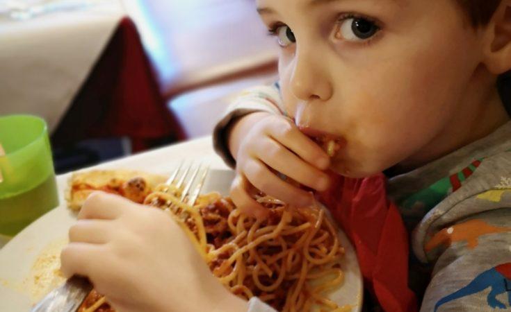 Eating spaghetti bolognese